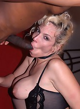 Buxom blonde playing with..