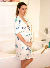 Hot preggy brunette getting wet in the bathtub