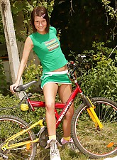 Brunette on a bike stopping..