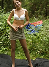 Adorable teen chick gives a detailed tour of her tight young body right in the forest