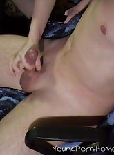 This hot young babe gives her man a good handjob when she catches him watching porn