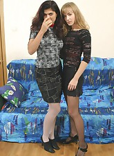 Two hot girls play lesbian games in bed