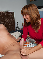Hot redhead MILF seduces one..